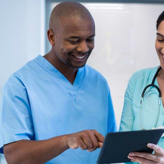 Medical-Staff-looking-at-tablet-1000